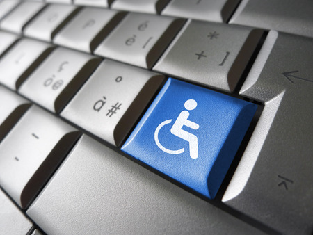 Foto de Web content accessibility concept with wheelchair icon and symbol on a blue computer key for blog and online business. - Imagen libre de derechos