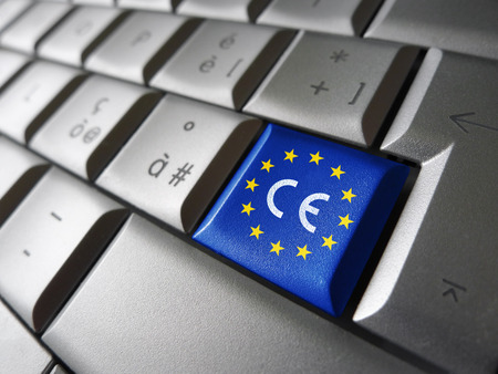 Foto de European Union and EU community CE marking concept with sign, symbol and EU flag on a computer key. - Imagen libre de derechos