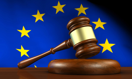 Photo for European Union law, legislation and parliament concept with a 3d render of a gavel on a wooden desktop and the EU flag on background. - Royalty Free Image