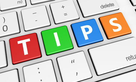 Foto de Tips and tricks concept with tips sign and letters on a colorful laptop computer keyboard 3d illustration for blog and online business. - Imagen libre de derechos