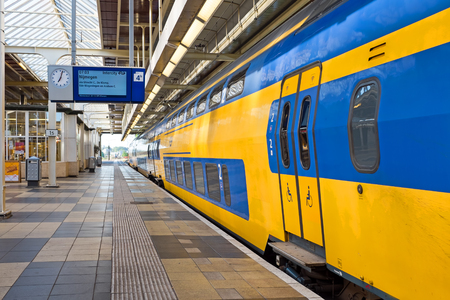 Photo pour Train departing from Amstel station in Amsterdam the Netherlands - image libre de droit