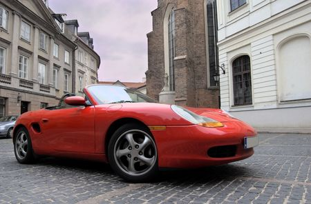 Red sport car in the old town scenery