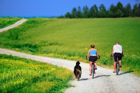 Photo pour Mature couple on bike. Sport, active lifestyle - image libre de droit
