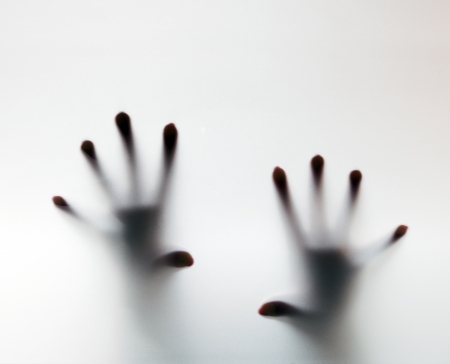 Photo pour Hands touching frosted glass. Conceptual scream for help, depression, stress, panic - image libre de droit