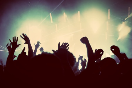 Photo for People with hands up having fun on a music concert, disco party. Vintage, retro style - Royalty Free Image