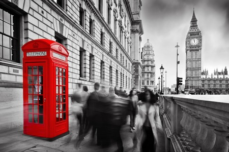 Photo pour Red telephone booth and Big Ben in London, England, the UK  People walking in rush  The symbols of London in black on white  - image libre de droit