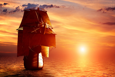 Foto de Ancient pirate ship sailing on the ocean at sunset. In full sail. - Imagen libre de derechos