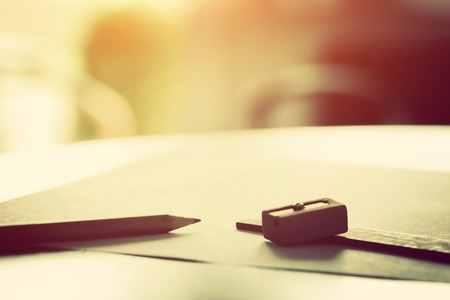 Photo for Penci, ruler and sharpenerl lying on blank piece of paper in morning light. Creative work, drawing etc. Vintage natural mood - Royalty Free Image