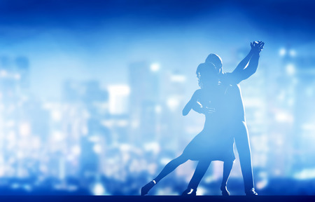 Foto de Romantic couple dance. Elegant classic pose. City nightlife background - Imagen libre de derechos