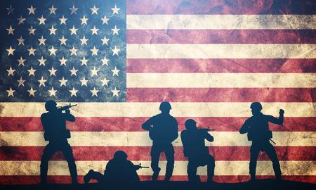 Foto de Soldiers in assault on grunge USA flag. American army, military concept. - Imagen libre de derechos