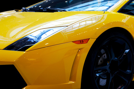 Foto de Modern fast car close-up background. Luxury, expensive, sports auto. - Imagen libre de derechos