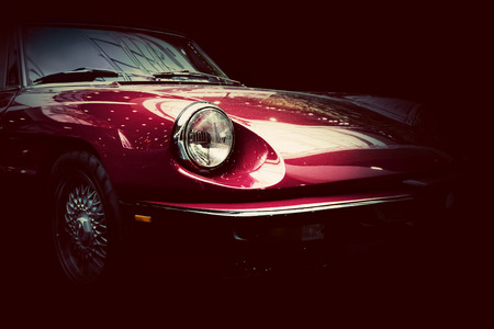 Photo pour Retro classic car on dark background. Vintage style, elegant. - image libre de droit
