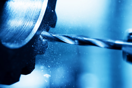 Foto de CNC turning, drilling and boring machine at work close-up. Industry, industrial concept. - Imagen libre de derechos