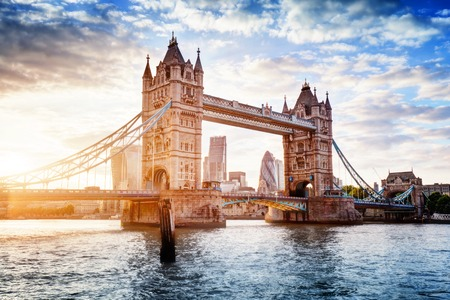 Photo pour Tower Bridge in London, the UK. Sunset with beautiful clouds. Drawbridge opening. One of English symbols - image libre de droit