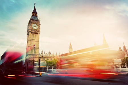 Photo pour London, the UK. Red buses in motion and Big Ben, the Palace of Westminster. The symbols of England in vintage, retro style - image libre de droit