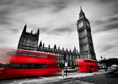 Foto de London, the UK. Red buses in motion and Big Ben, the Palace of Westminster. The icons of England in black and white with red colour. - Imagen libre de derechos