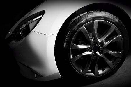 Photo pour Luxury sports car close up of aluminium rim and headlight. Garage - image libre de droit