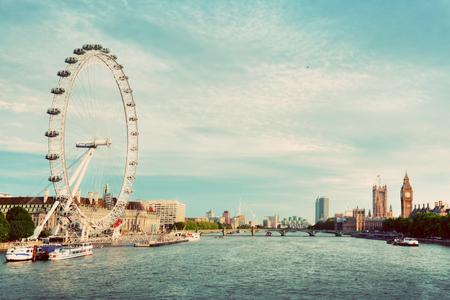 Photo pour London, the UK skyline. Big Ben, London Eye and River Thames view from Golden Jubilee Bridges. English symbols. Vintage - image libre de droit