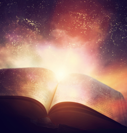 Photo pour Open old book merged with magic galaxy sky, universe, stars. Concept of literature, fantasy, horoscope, religion etc. - image libre de droit