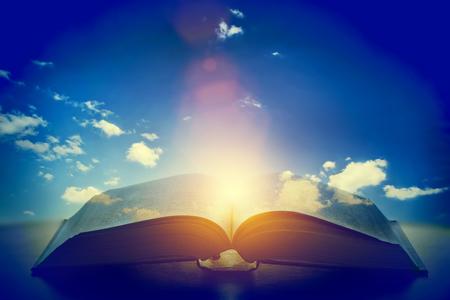 Foto de Open old book, light from the sky, heaven. Fantasy, imagination, education, religion concept. - Imagen libre de derechos