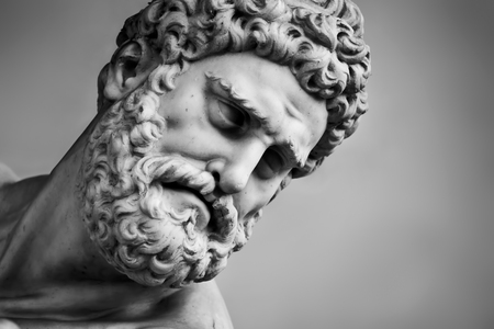 Photo for Ancient head close-up sculpture of Hercules and Nessus in Loggia dei Lanzi in Florence, Italy. Black and white - Royalty Free Image