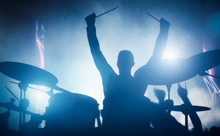 Photo for Drummer playing on drums on music concert. Club lights, artist show. - Royalty Free Image