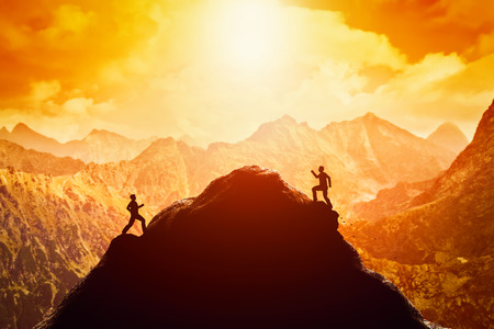 Foto de Two men running race to the top of the mountain. Competition, rivals, challenge in life concepts - Imagen libre de derechos