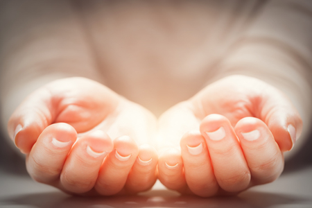 Foto de Light in woman's hands. Concepts of sharing, giving, offering, new life - Imagen libre de derechos