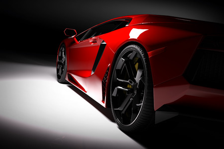Foto de Red fast sports car in spotlight, black background. Shiny, new, luxurious. 3D rendering - Imagen libre de derechos