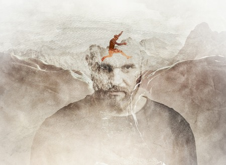 Photo pour Multiple exposure composition of man jumping between the mountains blended into man's head. - image libre de droit