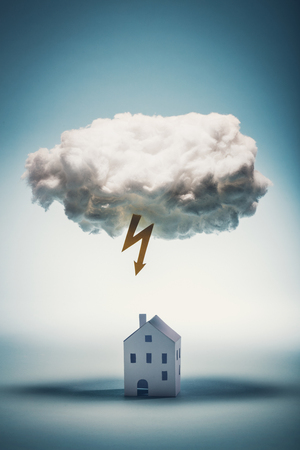 Photo pour Paper house standing under a white cloud with yellow lightning. Natural distasters. Insurance concept. - image libre de droit