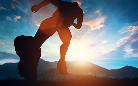 Photo for Man running towards the sunset in the mountains. Outdoor activities. Exercising and workout. - Royalty Free Image