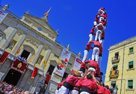 Photo for Tarragona, Spain - September 16, 2012: Castells in Tarragona, Spain. Every year, during Santa Tecla festival, those typical catalan human towers are performed in Plaza de la Font - Royalty Free Image
