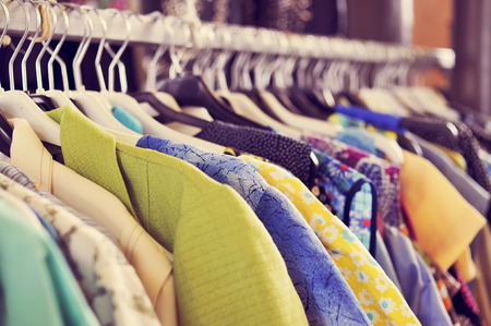 Photo for some used clothes hanging on a rack in a flea market - Royalty Free Image