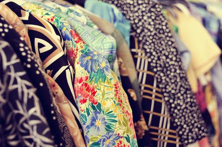 Photo pour some used clothes hanging on a rack in a flea market - image libre de droit