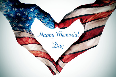 Photo for the text happy memorial day written in the blank space of a heart sign made with the hands of a woman patterned as the flag of the United States - Royalty Free Image