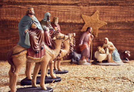 Foto de the three kings on their camels and the holy family in a rustic nativity scene - Imagen libre de derechos