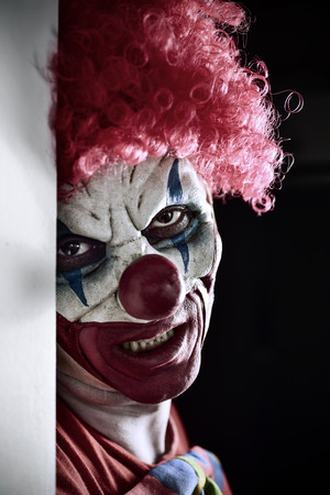 Photo for portrait of a scary evil clown against a dark background - Royalty Free Image