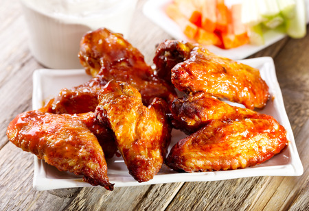 Photo for plate of chicken wings on wooden table - Royalty Free Image