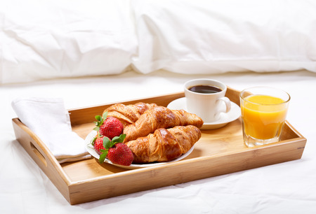 Photo for breakfast in bed with coffee, croissants, strawberries and juice - Royalty Free Image