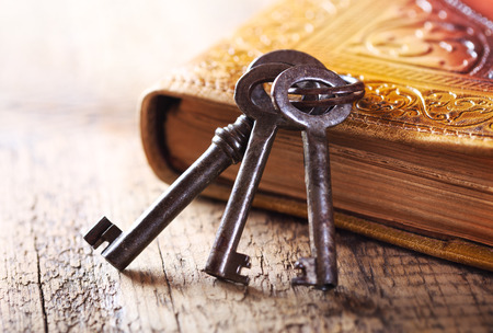 Photo for old keys with old book on wooden table - Royalty Free Image