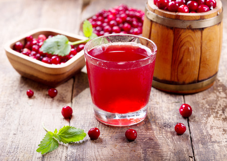 Photo for glass of cranberry juice with fresh berries on wooden table - Royalty Free Image