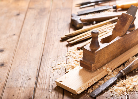 Photo for old tools: wooden planer, hammer, chisel  in a carpentry workshop on wooden table - Royalty Free Image