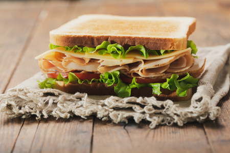 Photo for sandwich with ham and vegetables on wooden table - Royalty Free Image