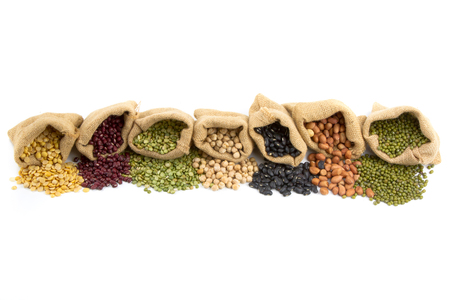 Foto de Various of legumes in sack bag isolated white background - Imagen libre de derechos