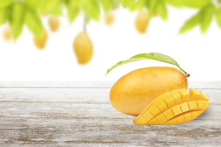Photo for Mango fruit cut and slice put on white table with frame of green leaf and isolated background - Royalty Free Image