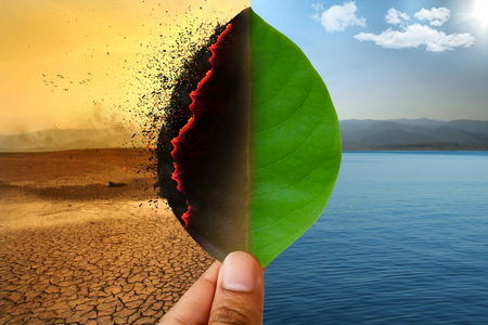 Photo pour Climate change and Global warming concept. Burning leaf at land of cracked earth metaphor drought and Green leaf with river and beautiful clear sky metaphor Abundance of Nature. - image libre de droit