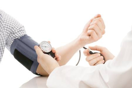 Photo pour Blood pressure measuring. Doctor measuring patients blood pressure - studio shoot isolated on white - image libre de droit