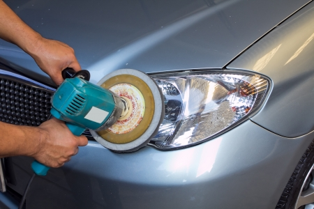 Car headlights with power buffer machine at service station - a series of CAR CARE images