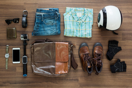 Foto de hipster clothes and accessories on a wooden background, View from above with copy space - Imagen libre de derechos